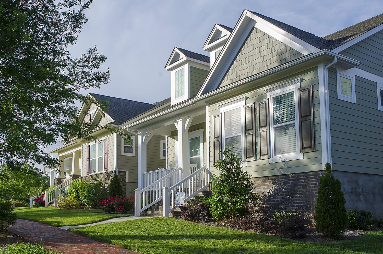 green-siding-house